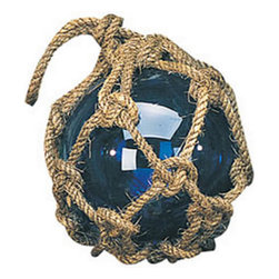"""7"""" Blue Glass Buoy Float (other colors available) - This glass float measures 7""""Dia. It is available in blue, green  purple. In years past glass floats were used to keep fishing nets from sinking. They are rarely used today but are a pleasant reminder of the way things used to be. The floats are encased in decorative rope nets that are used for hanging. This item will add a definite nautical touch to whatever room it is placed in and is a must have for those who appreciate high quality nautical decor. It makes a great gift, impressive decoration and will be admired by all those who love the sea."""