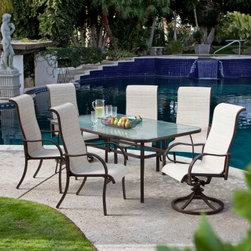 Coral Coast Del Rey Deluxe Padded Sling Dining Set - Seats 6 - With enough room for your whole family and maybe even a couple of neighbor kids the Del Rey Deluxe Padded Sling Dining Set - Seats 6 keeps everyone seated and comfy while you enjoy your patio or poolside. This set includes four dining chairs and two swivel chairs in your choice of sling color. Both the table and chairs start with a frame of rust-proof aluminum covered in a bronze powder-coat finish that is complemented by the fabric of the sling seat. The table features a central hole to accommodate an umbrella and the dining chairs stack for convenient storage when not in use. Product Dimensions: Table dimensions: 72L x 42W x 27.5H inches Chairs: 30L x 26W x 45H inches Seat: 19W x 19D inches Seat Height: 16.5H inches Back Height: 28H inches Arm Height: 25H inches
