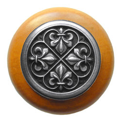 "Inviting Home - Fleur-de-Lis Maple Wood Knob (antique pewter) - Fleur-de-Lis Maple Wood Knob with hand-cast antique pewter insert; 1-1/2"" diameter Product Specification: Made in the USA. Fine-art foundry hand-pours and hand finished hardware knobs and pulls using Old World methods. Lifetime guaranteed against flaws in craftsmanship. Exceptional clarity of details and depth of relief. All knobs and pulls are hand cast from solid fine pewter or solid bronze. The term antique refers to special methods of treating metal so there is contrast between relief and recessed areas. Knobs and Pulls are lacquered to protect the finish. Alternate finishes are available. Detailed Description: The Fleur-de-lis means ""flower of the lily"" It was used to represent French royalty. It was said that the king of France Clovis who started using the symbol of the Fleur-de-lis because the water lilies helped guide him to safety and aided him in winning a battle. The design in the Fleur-de-Lis pulls is arranged in alternating positions of the Fleur-de-lis. These pulls are a great match for the Fleur-de-lis knobs which have the Fleur-de-lis pattern arranged in a circle. The different shapes of decorative hardware make the cabinet doors and drawers interesting to look at."