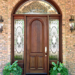 "Estate Doors - Pictured is our 36"" X 96"" Style E-R Door, DbyD-1108,  with standard molding on both sides with a pair of 20"" Sidelites and a custom segment transom.  The glass is leaded clear custom beveled and textured glass. This entry was stained and finished with a dark walnut stain and has Baldwin Springfield 6530-003 Polished Brass Hardware with a lifetime finish.  This door is installed on a custom home in Auburn, Alabama."