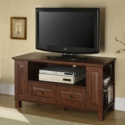 Walker Edison 44-in. Multi-purpose Wood TV Console - Traditional Brown - Storage - check. Style - check. Easy to use - check. The Walker Edison 44-in. Multi-purpose Wood TV Console - Traditional Brown is a complete package. Offering multiple storage and organizational features this TV stand is fashioned in a casual-traditional style that's easy to admire.Crafted from durable laminate and MDF (a dense warp-resistant engineered wood) this handsome TV console has a center open shelf for your DVD player and other audio-visual components as well as a two lower drawers that can hold remotes game controllers and other accessories. Organize your movie and game collections on the four side shelves for easy access. Framed front panels and block-style posts suggest a casual traditional design while two brass-finished knobs accent the warm brown finish. The console's strong top holds most flat panel TVs measuring up to 44 inches wide. Electronic wire management holes in the back panel keep cords out of sight and under control.About Walker EdisonSpecializing in quality furniture at low prices Walker Edison Furniture Company manufactures a wide variety of furniture pieces for the North American marketplace. From bedroom furniture and desks to coffee tables dining tables and TV stands Walker Edison provides practical decor solutions for today's functional homes. With factories strategically located all over the world Walker Edison balances cost with low-priced raw materials and skilled artisans to deliver smart furniture pieces that fit every budget.