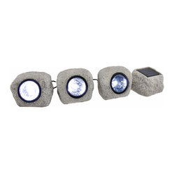 n/a - Set of 3 Solar Rock Shaped Garden Spotlights - This set of solar rock garden spotlights is a wonderful addition to gardens and flower beds. Each resin rock measures 3 inches tall, 4 inches long, 3 1/2 inches wide, and contains 3 bright white LED bulbs in the center. The solar panel rock is 2 inches tall, 3 3/4 inches long, 3 1/4 inches wide, and contains a switch on the bottom to turn the lights off, or have them come on automatically in dark conditions. The lights are connected by black cords with about 4 feet of space between each rock- perfect for circling around a tree, fountain, or statue, or to light a flower bed.