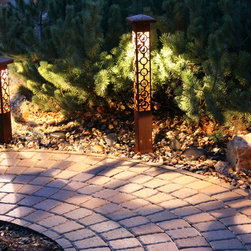 Attraction Lights overview - Circle Cross 4x4 Series, 4x4 Bollard, Grande Path and Path Light, natural rust finish, LED lamps.  Photo by Lyle Braund