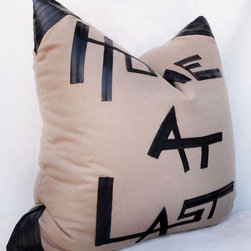 "Oversized Floor Pillows - 28"" x 28"" oversized floor pillow.  Recycled bicycle inner tube detail.  Handmade and one-of-a-kind.  Wool.  Colors - beige or taupe w/ black. Treated for stain resistance.  Pillow insert included with 25/75 duck down.  Zipper closure."