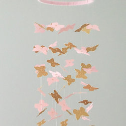 """Mobiles - This ultra-chic and stylish mobile will be sure to be the centerpiece of your space! Adorable butterflies in light pink and gold hang delicately from an 8"""" wide ring wrapped in pink. Gold beads create a rich look that will be sure to please even the most discerning tot."""
