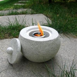 Terrazzo Fire Pot - A unique alternative to traditional candle arrangements, the Terrazzo Fire Pot allows you to effortlessly accent your outdoor décor. Add a romantic accent to your outdoor gatherings by using these unique Fire Pots as centerpieces for your table while dining alfresco, or add the unexpected by placing throughout the garden, patio, deck or walkway, or even leading up steps. Enjoy the glowing ambience of the golden flames which burn smokeless and odorless for hours by filling the stainless steel fuel gel reservoir with regular or citronella fuel gel (sold separately). Each pot comes with a stainless steel snuffer for safe and easy flame extinguishing.