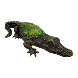 Green Crackle Glass Alligator Table Accent Lamp - This beautiful green crackle glass alligator table lamp adds the perfect accent to desks or nightstands of alligator lovers. Measuring 12 1/2 inches long, 4 1/2 inches wide and 2 1/2 inches deep, the lamp features an antiqued bronze finished resin base, head and tail, while the back of the alligator is made of bits of green crackled glass.  The lamp uses one nightlight style bulb (included). It makes a great gift idea. We have a very limited supply of these, so don`t delay. Get yours now!