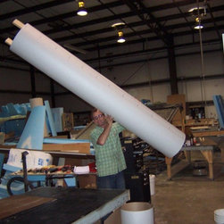 Various Curve products - Two piece system to cover pipes, I-beams. Finishes just like drywall. Very light, as you can see Keith holding the cover up in the air.