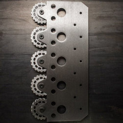 Warehouse Barn Door Hardware - Defined by its substantial metal plate and a five wheel configuration, this roller hanger was uniquely designed for an industrial yet modern application. Characterized by symmetrical circles and mitered corners, this hanger is truly unique. This hanger mounts to the face of the door.