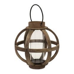 IMAX - IMAX Garrett Wood Lantern - 56393 - Shop for Candle Holders from Hayneedle.com! The round IMAX Garrett Wood Lantern is crafted from bowed bands of genuine fir that wrap around a cylindrical glass hurricane. This wonderfully rustic lantern also features a dark brown finish iron accents and a hanger so you can affix it to a wall hook and create a more charming atmosphere.About IMAXWhat began as a small company importing copper flower containers in 1984 by Al and Faye Bulak has developed into one of the top U.S. import companies serving the At Home market today. IMAX now provides home and garden accessories imported from twelve countries around the world housed in a 500 000 square foot distribution center. Additional sourcing product development and showroom facilities in the USA India and China make IMAX a true global source. They're dedicated to providing products designed to meet your needs. This is achieved through a design and product development team that pushes creativity taste and fashion trends - layering styles periods textures and regions of the world - to create a visually delightful and meaningful environment. At IMAX they believe style integrity and great design can make living easier.