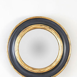 Pimiloco Bull's-eye Wall Mirror, Navy and Gold - Reminiscent of a porthole — without being too kitschy — this mirror is ideal for a beach house. We'd use a pair over a pair of pedestal sinks in a little boy's bathroom to bring in the spirit of sailing.