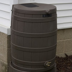 Good Ideas 50 Gallon Rain Wizard Flat Back Rain Barrel - The Good Ideas Rain Wizard Flat Back Rain Barrel is a stylish and easy way to catch and store rainwater that would normally just drain onto the ground and be lost. All you have to do is position this molded plastic barrel under your down spout and water will pass through the screen and into the barrel for use later. Child and pet proof this rain barrel will hold up to 50 gallons of pure rainwater which can be used to water gardens and potted plants. Made of plastic resin this rain barrel is resistant to rust mold mildew rotting UV rays fading and deterioration. The spigot is made of high-quality brass which lasts longer and is more reliable than plastic spigots found on other models. Especially useful during dry seasons the Rain Wizard is a smart and inexpensive investment that will pay for itself several times over in water bill savings. Please note - the brass spigot is included with your rain barrel. It is shipped inside the barrel - remove before use. An Eco-friendly Practice: Using a rain barrel is one way you can become more environmentally conscious. Saving rain water reduces the amount of usable water you need which decreases demand for treated water and saves you money. Because the rain barrel catches water that would normally flow to the ground it also helps the environment by reducing runoff waste water. Storing rain water can also supply you with an alternative water source during dry weather spells. And to top it all off rain water is healthier for plants than tap water. What are you waiting for? Order a rain barrel today and go green. About Good Ideas Inc.Based in Lake City Penn. Good Ideas Inc. was founded in 2001 and has been promoting green living ever since. Many of their innovative products have been featured in magazines newspapers TV shows and news stories. Good Ideas' products focus on sustainability and are developed from practical common-sense ideas generated from consumer needs. Good Ideas' great products include the Rain Wizard Big Blue Rain Saver Compost Wizard and many more.