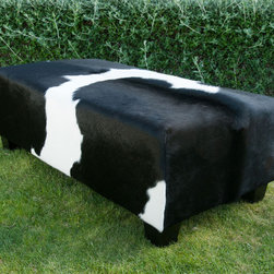 Gorgeous Creatures New Zealand - Black and white cowhide ottoman - A classic yet modern black and white cowhide ottoman coffee table with low wooden legs.