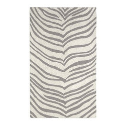 Safari Rug | West Elm - I love the chic print of zebra rug, but I'm not a fan of hides. This rug gives me the pattern without the guilt trip, and the silver stripes are a more subtle contrast than typical black and white.Dimensions vary. Available in different sizes. Price ranges from $99 to $649.