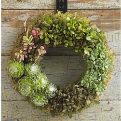 "Viva Terra - Succulent Wreath and Hanger - Hand-assembled into five groups of green-gray, burgundy and silver succulents, the design of this living wreath features each plant's distinctive textures, leaf patterns, and colors. As eco-friendly as it is enchanting, the succulents include water-saving crassia, lichen and other unique yet compatible varieties that thrive with minimal watering every three to eight weeks. 13""D"