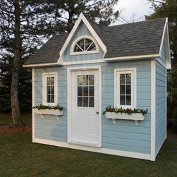 Summerwood Product - Copper Creek Shed - Featuring flowerboxes and painted a pretty light blue by this Deshler, Ohio customer, our Copper Creek looks right at home in this very natural setting. The flowers just brighten up the whole look.