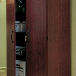 South Shore - Traditional Jefferson Cherry Two Door Floor Cabinet - South Shore's stylish and family-friendly furniture is made of laminated engineered wood, which gives it great strength and durability. They use wood panels entirely made from recovered and recycled material. While they do their share to preserve the environment by conserving our forests, South Shore Industries makes no compromise when it comes to quality and product durability. These quality products are designed for easy maintenance and offered at very competitive prices. Neatly store any of your items with this simple, classic cabinent. Large enough to store any of your items without creating a cluttered look in your room. This model features durable construction and an attractive Traditional Jefferson Cherry finish. Features: -Constructed of particleboard with Traditional Jefferson Cherry finish. -Features two doors and ample shelving space. -Ships ready-to-assemble. -Comes with three adjustable shelves. -5-year manufacturer's limited warranty. About South Shore Industries: South Shore Industries Ltd. brings over 65 years experience to the manufacturing of its furniture products and boasts a highly skilled production team with an eye for detail. A recognized leader in North American furniture manufacture, South Shore Industries was established in 1940 and has been making furniture for three generations. Employing a team of over 1000 employees in three factories in Quebec, their assembled and ready-to-assemble furniture has a reputation for quality and excellence at affordable prices for today's family. Protecting our Environment for Generations to Come! South Shore Furniture is proudly taking a stand on its environmental positioning and is supporting its words with very concrete actions and a vision for a healthy future. Current actions include: -Improved packaging  Our new packaging use 60% less non-biodegradable materials. -Energy efficiency  Yearly, 5 to 6 tons of wasted paneling are converte
