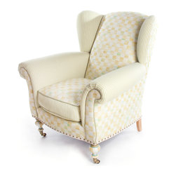 """Parchment Check Underpinnings Classic Wing Chair   MacKenzie-Childs - In what we like to call our """"new neutral"""" palette, we've taken our successful new pattern—Parchment Check™—and exquisitely printed it in Italy on highest-quality cotton viscose. Parchment Check™ blends tones of ivory, wheat, ochres, and aquas, and has been widely accepted as our new hallmark. We playfully mix it with ticking stripes and hand-painted elements for a furniture line that is soft, elegant, and adaptable to so many settings. Think Downton Abbey meets Big Sur. The Parchment Check™ Underpinnings Collection is lovely and demure, yet energetic and unique, and now available on our classic wing chair. Made in the U.S., all Underpinnings pieces feature an eco-friendly frame of sustainably harvested hardwood and eight-way hand tied coil construction for outstanding comfort. All green-manufactured in our commitment to domestic manufacturing and responsible practices."""