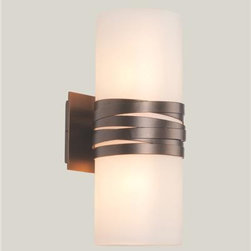 Lightspann - Cyclone I Glass and Metal Wall Sconce - The Cyclone I wall sconce is shown here with a frosted glass cylinder wraps with layers of metal strapping, shown with our Flat Bronze finish.         This sconce accepts two incandescent, candelabra base 60 watt bulbs.          Handcrafted in the USA!  This fixture usually ships in 8-10 weeks.           Standard Metallic Metal Finishes: (image 2 - included in price)  Copper Leaf, Flat Bronze (shown), Matte Black, Seaside Silver, Metallic Beige Silver, Statuary Bronze      Please note that the price listed pertains to a fixture that will appear very similar to the light shown in the featured photograph and as outlined in the accompanying description. Virtually all of our artisan crafted fixtures can be customized regarding size, shape, and / or color(s). Please call for details.