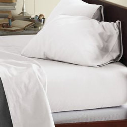 Garnet Hill - Garnet Hill Signature Cotton Flannel Sheets - California King - Fitted - White - This Signature Flannel bedding is crafted in Germany with a tighter weave than most flannels, making it weightier and more durable. It is gently brushed multiple times on each side until it meets our exacting standards for softness. Cases have an inner flap to conceal the pillow for a neater, more finished look. Our universal fitted sheet is elasticized all the way around for an easier fit. 12-inch pocket depth. Monogramming available.