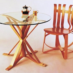 "Knoll � - Face Off Counter Height Dining Table - The Design Inspired by the woven construction of apple crates from his childhood, Frank Gehry used an interwoven maple strip design to form the eye-catching base of the 36"" Face Off Cafe Table. To finish the table's overall appearance, an elegant round top is available in either clear glass or white laminate. The Face Off Table can either take center stage on its own or create a striking effect when paired with Gehry Side and Dining Chairs. Features at a Glance: *This product is made to order and thus customer orders cannot be canceled once the products go into production Design Year: 1992 -Base constructed of hard white maple veneers in 2"" wide, 1/34"" thick strips -All wood grains run in the same direction for resilience -Laminated to 7-ply thickness with high bonding urea glue -State-of-the-art glue provides structural rigidity without need for metal connectors -Solid maple center column prevents cracking -Arched base design provides ample leg room -Clear plastic glides with a matte frost finish -Top available in 1/2"" thick tempered glass with polished edge or 5/8"" thick white textured laminate with clear solid edgeband -Underside embossed with Frank Gehry's signature and the Knoll logo -Shipping Note: Tables with clear glass top option are available for shipment within twenty working days. This offer subject to availability. Dimensions:  -Overall Dimensions: 28.75"" H x 36"" Diameter Order with Confidence:  -Sustainability Statement: Sustainable design is a key component of Knoll's environmental focus. Knoll's commitment to social responsibility and a healthy environment has prompted the company to further articulate its longstanding environmental programs and, with encouragement and support from colleagues in the industry, Knoll has re-energized its focus on such ""green"" initiatives as life cycle analysis and LEED certification. Knoll is proud to have contributed to projects that have received LEED certification from the U.S. Green Building Council. -Knoll products are guaranteed to be free from defects in materials and workmanship during the applicable warranty period set forth in the Knoll Warranty. -Should you discover shortly after receiving your Face Off Cafe Table that parts are either damaged or missing, please call us immediately, and we will be happy to send you replacement parts as soon as possible and at no additional cost. -Each authentic Knoll product includes a certificate of authenticity. ."