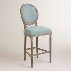 World Market - Blue Linen Paige Barstool - A classic with a round back silhouette, our Blue Linen Paige Barstool is crafted of American white oak with carved details and a distressed finish. Plush linen upholstery makes this exclusive barstool a stylish seating update for the home bar.