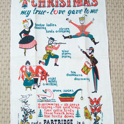 12 Days of Christmas Linen Tea Towel by 2 Numerous - A vintage tea towel would make a perfect hostess gift, or it could just add some holiday flair to your kitchen.