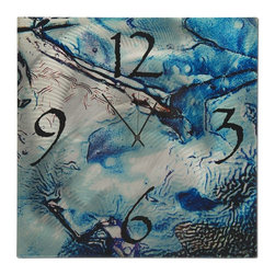 Metal Art Studio - Cool Jazz Clock Metal Art - Cool Jazz Clock is a modern metal artistic clock, created at Metal Art Studio.  This abstract clock is made from a single sheet of metal infused with a modern design and a functional clock. The splash of blue and the pattern found in the piece resembles water filling a glass full of ice. Subtle ripples on the sheet of metal give the piece another dimension and movement, giving the sheet of metal life. Like jazz, this piece has an element of spontaneity and vitality with a hint of improvisation. The mere randomness of the patterns, figures, and shades used on the sheet of metal is a tribute to jazz. The level of abstraction in the piece makes it very hard to define but observers can easily recognize the message conveyed by the piece. Nevertheless, it is an interesting piece to display in any modern space.
