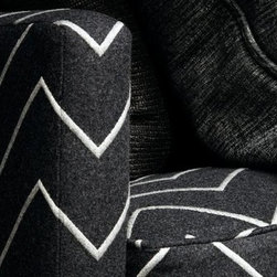 Zorin (Decorative Weaves) - Zync. A sharp, essentially masculine collection featuring reversible wool flannels juxtaposed with sexy simulated leathers, witty cut velvets and faux hides. Textured chenilles, pleated wools, a smart ottoman and wool epingle complete this sartorial collection.
