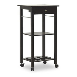 Wholesale Interiors - Coppinger Dark Brown Modern Wine Cart - A no-brainer for the wine aficionado or enthusiastic hostess, this small modern beverage cart tucks away into a corner or rolls to where the party is! The Coppinger Contemporary Serving Cart stands upon four black plastic casters, making it easy for you to wheel around a tray of appetizers, beverages, and more. Two of the wheels feature a locking function for peace of mind and a single small drawer is included, ideal for a corkscrew and napkins. A solid rubber wood and engineered wood frame with dark brown finish is brought to life in Malaysia and, on the bottom shelf, includes slots for three bottles of wine or spirits (horizontal wine bottle storage). The modern serving cart with wheels is snugly packaged in a cardboard carton and requires assembly. To clean, simply wipe the cart clean with a dry cloth.