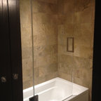 Frameless Shower Door with splash panel for tub - Frameless operating splash panel for tub.  Configured with full heighted fixed panel and operating panel hinged off of the glass.