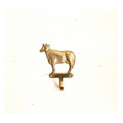 Vintage Brass Cow Hook by Caprock Vintage - This would look cute in the kitchen for upgrading an apron or dish towel.