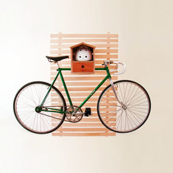 Hello Birdhouse Bike Rack - This one's not for the birds. It's for your bike! Made from mahogany ply with hand-rubbed oil finish, this bike rack makes indoor bike storage a breeze. Mounting is made easy and requires no power tools. It's ready to store your bike after just 10 minutes of assembly!