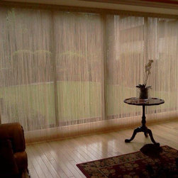 Vertical Blinds - A variety of colors and patterns being not only elegant but practical and synchronized