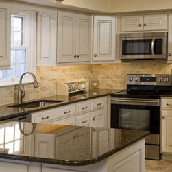 "Period Inspired Restored Kitchen Cabinets - Period Inspired ""Colonial"" paint with hand applied antique ""Van Dyke"" glaze."