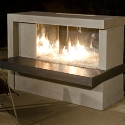 American Fyre Designs Manhattan Linear Outdoor Fireplace - Just like your style, the American Fyre Designs Manhattan Linear Outdoor Fireplace is ultra contemporary. Designed to make a style statement, this outdoor fireplace has a linear design and uses the power of polished stainless steel and clear Fyre gems to sparkle in the firelight. A well-designed outdoor essential, this fireplace is made of reinforced fiberglass concrete for use in any climate. The body has a neutral Silverado finish, the hearth shelf in contrasting Black Lava for visual drama. Your kit includes the hearth shelf, fireplace body, polished stainless steel firebox, and 20 pounds of clear Fyre gems. Simply choose your fuel source (natural gas or liquid propane). To assemble, stack and bolt together on your existing concrete pad or backyard area.Note: Review any building restrictions or construction permit requirements before installation of an outdoor fireplace. Contact your local zoning commission/homeowners association for details.Contact a licensed contractor for installation as this product may require connection to a natural gas line.About American Fyre DesignsR. H. Peterson Company, a premium gas product manufacturer, launched American Fyre Designs in 2013. This complete line of uniquely designed and handcrafted exterior fire features are meant to meet the growing demand for outdoor living products. Pre-fabricated exterior fireplaces, fire tables, urns, pits, walls and BBQ islands make up this unique line and each item is constructed of durable, lightweight glass fiber reinforced concrete. Everything in the American Fyre Designs line is made in the USA and follows strict quality standards using advanced technology.