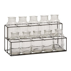 11-Pc. Glass Bottle Display - Add some vintage charm with this array of ten open glass bottles set in a slim metal wire tray. They'd make for a charming flower arrangement.