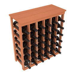 36 Bottle Kitchen Wine Rack in Redwood - A small wine rack with big storage. This wine rack kit is the best choice for converting tiny spaces into big wine storage. The solid wood top excels as a table for wine accessories, small plants, and wine collectables. Store 3 cases of wine properly in a space smaller than most entry tables!