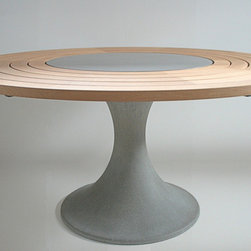 Dining Tables - Five rings of white oak sitting around a slim finely-balanced pedestal in fine architectural-quality concrete.  By Steven Pollock in Vancouver, BC, available through Kozai Modern.