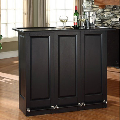 """Crosley - Mobile Folding Bar in Black - Elegantly entertain guests with this mobile folding bar cabinet constructed of solid hardwood and wood veneers. The bars handsome raised panels are classically styled to enhance any home decor. The unit can be folded up to a third of its size and tucked away when you are finished entertaining, or just leave it open as a focal point in your room. Behind the bar, you will find plentiful storage space for spirits, glassware, and a host of other bar items. When open, the large 49-by-22-inch top is ideal for serving drinks or just hanging out with friends. Style, function, and quality make this mobile folding bar a wise addition to your home. Features: -Hardware finish: Brushed nickel. -Solid hardwood and wood veneer construction. -Sturdy foot rail with brushed nickel accents. -Hidden casters for mobility when folded up. -Open and closed storage. -Adjustable levelers for stability. -Folds up to 0.33"""". -When open the large top dimension: 42"""" - 49"""" H x 22"""" D. -Assembly required."""