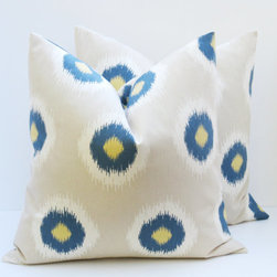 Ikat Throw Pillow Covers, Blue by Posh Street Pillows - I'm seriously considering these for my boys' shared bedroom. The room has muddy gray walls, blue and white striped duvets and oversize burnt orange velvet pillows. These patterned ikat spot pillows could work!