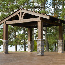 Outdoor GreatRoom - The Lodge Pergola gives the feeling of an authentic mountain lodge. The reinforced concrete columns and fiberglass beams is weather proof and low-maintenance. Enjoy sitting out under a beautifully-crafted structure, while it protects you from the elements. Get it at www.outdoorrooms.com