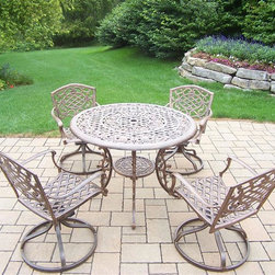 Oakland Living - 5-Pc Handcast Outdoor Dinning Set - Includes table, four swivel rockers and metal hardware. Traditional lattice pattern and scroll work. Handcast. Hardened powder coat. Fade, chip and crack resistant. Warranty: One year limited. Antique bronze finish. Minimal assembly required. Table: 42 in. Dia. x 29 in. H (44 lbs.)The Oakland Mississippi collection combines southern style and modern designs giving you a rich addition to any outdoor setting. We recommend that the products be covered to protect them when not in use. To preserve the beauty and finish of the metal products, we recommend applying an epoxy clear coat once a year. However, because of the nature of iron it will eventually rust when exposed to the elements.