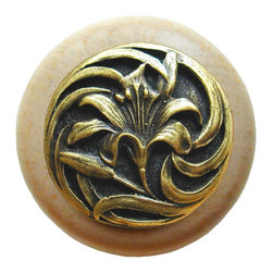 """Inviting Home - Tiger-Lily Natural Maple Wood Knob (clear finish with antique brass) - Tiger-Lily Natural Maple Wood Knob in clear finish with hand-cast antique brass insert; 1-1/2"""" diameter Product Specification: Made in the USA. Fine-art foundry hand-pours and hand finished hardware knobs and pulls using Old World methods. Lifetime guaranteed against flaws in craftsmanship. Exceptional clarity of details and depth of relief. All knobs and pulls are hand cast from solid fine pewter or solid bronze. The term antique refers to special methods of treating metal so there is contrast between relief and recessed areas. Knobs and Pulls are lacquered to protect the finish. Alternate finishes are available. Detailed Description: A very detailed and beautiful knobs are the Tiger Lily knobs. They are very delicate and bears a lot of positive history. The Tiger Lily is an orange flower that is covered in spots. It has been a useful medical remedy for many centuries. Its scent is said to suppress aggressive behavior and promotes overall good feeling. The smell is said as a superstition to give whoever smells it freckles."""