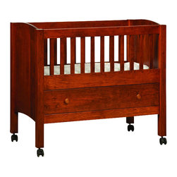 Chelsea Home Furniture - Chelsea Home Halifax Solo Bassinet-Drawer Pad not Included in Sap Cherry - Add the Solo Bassinet with-Drawer to your nursery, or at the foot of your own bed, to ensure your baby's absolute comfort at night. This Mission style bassinet is built strong with simple vertical and horizontal lines to go with any decor. Shown in Sap Cherry with Washington stain, complete with leg wheels for easy mobility, this gorgeous bedroom piece will last you for years to come. Chelsea Home Furniture proudly offers handcrafted American made heirloom quality furniture, custom made for you. What makes heirloom quality furniture? It's knowing how to turn a house into a home. It's clean lines, ingenuity and impeccable construction derived from solid woods, not veneers or printed finishes over composites or wood products _ the best nature has to offer. It's creating memories. It's ensuring the furniture you buy today will still be the same 100 years from now! Every piece of furniture in our collection is built by expert furniture artisans with a standard of superiority that is unmatched by mass-produced composite materials imported from Asia or produced domestically. This rare standard is evident through our use of the finest materials available, such as locally grown hardwoods of many varieties, and pine, which make our products durable and long lasting. Many pieces are signed by the craftsman that produces them, as these artisans are proud of the work they do! These American made pieces are built with mastery, using mortise-and-tenon joints that have been used by woodworkers for thousands of years. In addition, our craftsmen use tongue-in-groove construction, and screws instead of nails during assembly and dovetailing _both painstaking techniques that are hard to come by in today's marketplace. And with a wide array of stains available, you can create an original piece of furniture that not only matches your living space, but your personality. So adorn your home w