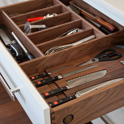 New England Design Works Showroom - Utensil drawer and knife storage drawer customized by Pennville Custom Cabinetry. Each knife has an insert routed for it as well as a label for each knife: bread, paring, boning, etc.