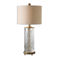 Uttermost - Tomi Glass Table Lamp - Water Glass Base With Heavily Antiqued Gold Details. The Round Hardback Drum Shade Is An Oatmeal Linen Fabric With Natural Slubbing. Number Of Lights: 1, Shade: Round Drum Hardback Shade, Shade Size: Height: 11, Top: 15w X 15d, Bottom: 15w X 15d, Voltage: 110, Wattage: 150w, Bulbs Included: No