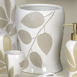 Shadow Leaves Wastebasket - The Shadow Leaves Wastebasket is a great addition to your relaxing and sophisticated bathroom. With elegantly contoured sides, this wastebasket has a glossy white finish with debossed sand-blasted leaves. It is made of durable ceramic and is suitable for any decor. Coordinating accessories are available.About Creative BathFor over 30 years, Creative Bath has developed innovative, stylish bathroom decor items. They have grown exponentially, and now you can find their products in major retail and online stores around the world. From shower curtains to soap dishes and everything in between, Creative Bath brings you high quality items to enhance your lifestyle.