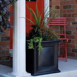 Mayne - Planter: Mayne Square Polyethylene Fairfield Patio Planter - Shop for Planters and Pottery from Hayneedle.com! If you're having no luck in the garden why not grow flowers in a planter on the patio instead? The Mayne Square Polyethylene Fairfield Patio Planter is conveniently sized to fit on almost any porch patio balcony or deck. It features a traditional framed-panel design with decorative molding on the top and bottom. This planter is designed with an innovative sub-irrigation system which reduces the frequency of watering by storing water in the base of the planter. The built-in water reservoir encourages healthy plant growth by allowing roots to absorb water as they need it from troughs in the bottom of the planter. That means you'll spend less time tending your plants and more time admiring your blooms. This attractive square planter is made of high-grade polyethylene which is a durable low-maintenance material for all-season use. The planter looks like wood but requires none of the maintenance that outdoor wood planters need such as painting and re-sealing. How does the Sub-Irrigation Water Reservoir work? These patio planters include a trough design creating a sub-irrigation water reservoir at the bottom of the planter. Capillary action allows water in the reservoir to soak upward keeping the soil and plant roots moist. To avoid oversaturation an overflow hole is drilled through the outside wall allowing excess water to drain out from the planter. Regular watering is required for the first few weeks giving the root system time to develop. Once the roots have grown down to the troughs the plants will be able to pull moisture from the reservoir creating a self-watering effect. About MayneSince its conception in 2005 Mayne Mail Posts has grown and expanded its line of distinct outdoor products. Based in London Ontario Mayne takes great pride in creating and designing high-quality products for your home including mail box posts planters address signs and lamp posts. Mayne's dedicated team continues to set high standards in order to provide you with service and quality worthy of remembering.