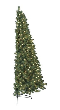 Murphy's Flatback Tree - Evoke the spirit of Christmas in small spaces with our Murphy's Flatback Tree. Featuring a flat back to conserve space, this 7-foot tree comfortably rests against the wall while providing a lush full-tree effect from the front.